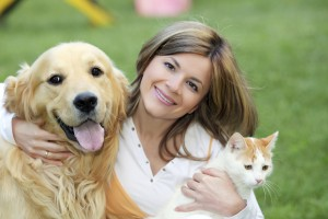Portrait of a young woman with dog and cat.